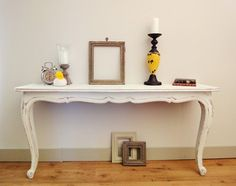 cut an old dining room table in half - make two console tables