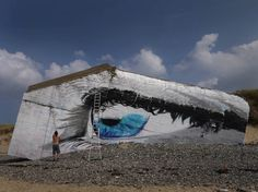 The_Eye_A_Beautiful_Mural_by_Street_Artist_Cece_on_the_Beach_of_Siouville_Hague_France_2015_02