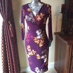 🌺 Ralph Lauren faux wrap dress NWT Ralph Lauren wrap style dress (faux, it is enclosed). Size 2. New with tags. Beautiful plum and yellow/gold colors. Ruching down front. See pictures. 95% polyester, 5% elastane. Ralph Lauren Dresses