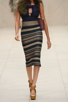Burberry skirt...If Michelle B. ever rocked heels, she would be a stunner in this skirt!