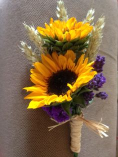 Double mini sunflower, wheat and lavender buttonhole by www.arrangingflowers.co.uk