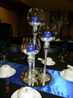 Set/3 stemmed hurricane globes, gems, royal blue round candles, mirror, royal blue table runner