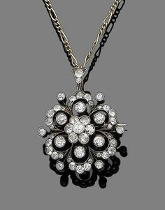 A diamond flower brooch/pendant, circa 1900 The stylised flowerhead, set throughout with old brilliant and single-cut diamonds, in collet and millegrain-settings, suspended from a detachable similarly-set loop, to a fancy-link chain