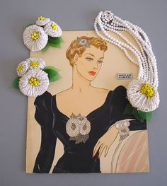 """Hess white glass bugle beaded flower necklace with yellow bead center and green pressed glass leaves, four strand necklace, circa 1940, 15"""" by 3"""", with matching clips of white beads and green glass leaves, 3"""" by 4"""", set of 2.  morninggloryjewelry.com"""