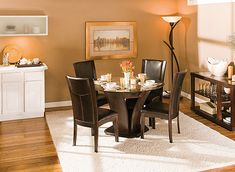 "This Venice 5-pc. 48"" glass dining set combines the small-scale coziness of casual dining with a more formal feel. The table features an elegant tulip base and a beveled glass tabletop that provides an open, airy feel. Plus, the easy-to-clean, faux leather chair seats provide a luxurious look."
