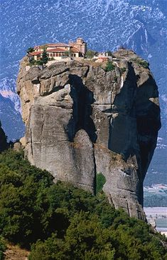 The Monastery of the Holy Trinity — Moni Agias Triados — is perched high on this seemingly inaccessible pinnacle in Thessaly, Greece (© George Tsafos/Getty Images) Wonderful Places, Great Places, Places To See, Beautiful Places, Places Around The World, Around The Worlds, Beautiful World, Wonders Of The World, Adventure Travel
