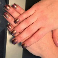 Shellac additives black on free edge then bronze faded in middle and pink iridescent at cuticle