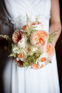 ranunculu and rose wedding bouquet. tree fern, jasmine vine, peach