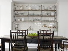 Love the table and chairs.  Antique English ladderback chairs surround the French farm table. Design: Mick de Giulio. Photo: Julian Wass. housebeautiful.com.