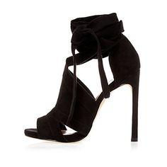 Black cut-out heel shoe boots