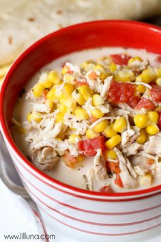 A hearty soup filled with chicken, corn and tomatoes.