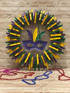 Seashell Wreath, Clothes Pin Wreath, Mardi Gras Decorations, Frame Wreath, Clothes Crafts, Wreath Crafts, Door Wreaths, Green And Purple, Clothespins