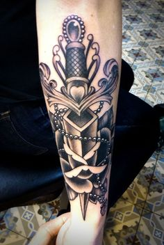 dagger through a rose tattoo by Tim Hendricks. Want. Bad. Now.