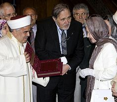 A copy of the Koran is presented to The Queen during a visit to the Yesil Mosque, also known as the Green Mosque, in Bursa, Turkey, May 2008.© Press Association
