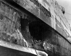 Torpedo damage to the hull of USS California (BB-44), photographed at the Pearl Harbor Navy Yard in April 1942, soon after the ship had been drydocked for repairs. This is California's forward torpedo hole, centered at about Frame 52. Note armor belt at the top of the hole and bilge keel below it.
