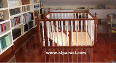 Cierre de escalera con barandilla torneada lacada en color blanco.  http://www.alpacasl.com/