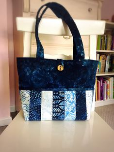 A personal favorite from my Etsy shop https://www.etsy.com/listing/586907170/quilted-tote-bag-with-batik