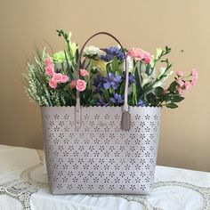 """New Coach totes COACH  FLORAL LASER CUT CITY TOTE Style # F38158 Color: Grey Birch Glitter Material: Floral Laser Cut Glitter Leather Shoulder bag with open top Silver tone hardware Inside one zip pocket and two slip pockets Handles with 10"""" inches drop Approx.: 13.5""""H x 6.5""""D x 11.5""""L MFSRP: $425 Coach Bags Totes"""