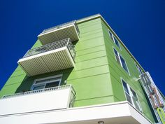 Our fiber cement trims can be painted to ColorMatch® any panels that are installed. Check out this bright green finished and painted QP install. See more ColorMatch® painted QP projects at the link below Cladding Systems, Panel Systems, Green House Siding, Bright Green, Exterior Design, Photo Galleries, Cement, Gallery, Fiber