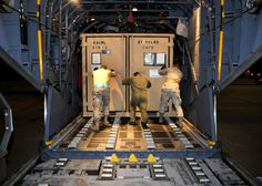 U.S. Airmen with the 27th Special Operations Logistics Readiness Squadron load cargo onto an MC-130W Combat Spear aircraft Jan. 13, 2010, at Cannon Air Force Base, N.M. Two aircraft and about 40 Airmen are departing Cannon in support of Haiti earthquake relief efforts. (U.S. Air Force photo by Airman 1st Class Maynelinne De La Cruz)