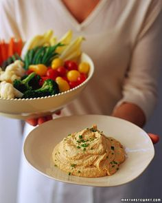Tangy hummus is perfect for parties or as a quick and healthful snack when served with a colorful array of fresh vegetables. Roasted garlic, fruity olive oil, and sesame tahini enliven the flavor.