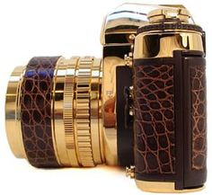 Gold and leather camera. #TreatYoSelf #ParksandRec If Tom Haverford has one of these... Maybe I should too!