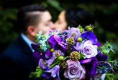 beautiful textural bridal Bouquet with Lavender roses, vanda orchids, clematis, scabiosa flowers, scabiosa pod, thistle, love in a mist, hydrangea, anemone and geranium foliage #bride #bridesbouquet #bridalbouquet #bridalflowers #purplewedding #purplebouquet #texturalbouquet #uniqueflowers #realwedding #springfieldIL #springfieldflorist #Illinoiswedding #midwestbride