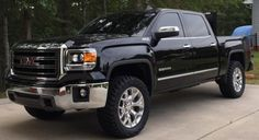 2015 SLT, RC leveling kit, tinted windows and windshield, Retro Source 6,500k HID headlights and Retro tinted 5,500k Led fog lights, 295/55/20 Nittos, color matched GMC emblems, AMI shorty antenna, Undercover flex bed cover