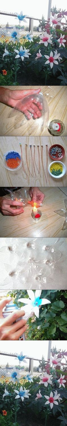 Flowers made from 2 liter bottles! Could Attach Christmas lights and have pretty flower lights. ...