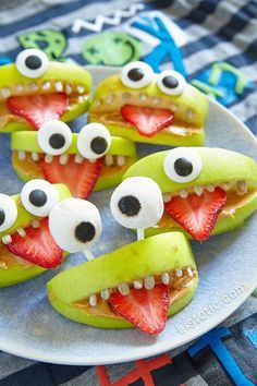 """These cute, little fruit monsters are not only adorable as can be, they're also a healthy snack option for Halloween! INSTRUCTIONS: Cut several strawberries length wise into little slivers to use as the tongues. Depending on the size of your strawberries, you should get about 2-4 """"tongues"""" each. Cut your apples into quarters avoiding the core, …"""