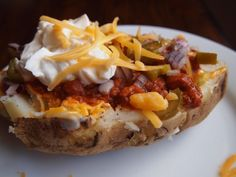 Chili Cheese Baked Potato .. Ooo sounds & looks good but no sour cream for me