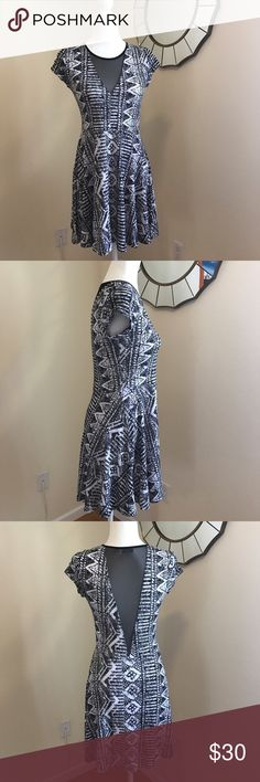 UO Kimchi Blue Mesh Dress Sz M Urban outfitters kimchi blue dress. Black-and-white pattern short sleeve skater dress in perfect condition. Mesh V in front and back. Size medium. No trades, thanks for looking! Urban Outfitters Dresses