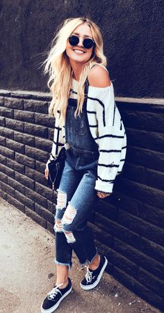 #winter #outfits white and black striped sweater with distressed blue denim overall pants and black-and-white Vans low-top sneakers