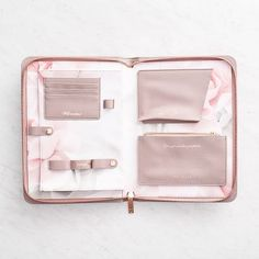 Sophisticated Ted Baker travel and lifestyle organizer takes care of all your organization needs! Blush, mauve and rose gold metallic accents make it a gorgeous gift. Includes a designated space for y
