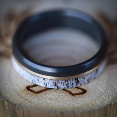 Antler Wedding Band with Black Metal and Gold. Handcrafted by Staghead Designs.
