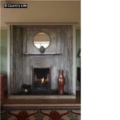 1895 Perrycroft  The marble fireplace in the drawing room at Perrycroft. The house was built to designs by C. F. A. Voysey in 1895.