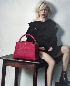 Louis Vuitton's latest ad campaign with Michelle Williams featuring the Capucines leather handbag