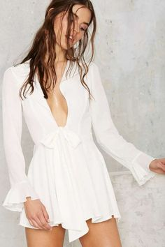 Rompers are just so cute, adorable and fun. I'm loving the the bell sleeves and deep plunge neckline on this one.