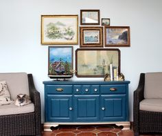 water/ocean themed gallery wall with lots of vintage and thrifted paintings and prints