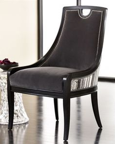 "A great accent chair for any room in your home, the ""Slated"" chair is upholstered in luxurious fabric and handsome nailhead trim."