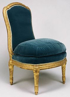 A padded side chair, once part of a fifteen piece set of seating furniture, bought secondhand for Louis XVI at Versailles.