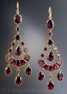 Antique Chandelier Garnet Earrings, Simply stunning, early-Victorian (maybe Georgian), almost 2 1/2 inches long drop earrings glistening with a multiplicity of multi-shaped, rich raspberry colored garnets, lovingly hand crafted and backed in 14K yellow gold. Rare, ravishing and romantic. 2 3/8 inches long and ust over 7/8 inch at the widest points. The earwires were added at a later date.