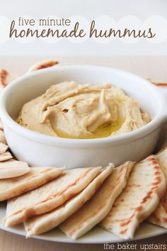 Easy hummus  <> I roasted the garlic cloves, and pureed the whole thing in my Nutribullet. It was easy, smooth, and delish!