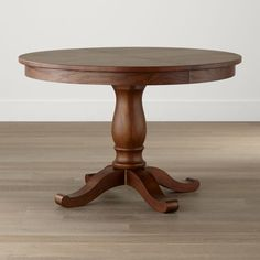 "Shop Avalon 45"" Tea Brown Round Extension Dining Table.   The open grain of its top is lightly stained to a beautiful, mid-tone brown.  Gracious in size, this family-friendly dining room table is designed by Blake Tovin of Tovin Design."