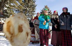 Women in traditional Belarussian dresses celebrate Maslenitsa, or Pancake Week, in the village of Rechen, Belarus. Maslenitsa is widely viewed as a pagan holiday marking the end of winter and is celebrated with pancake eating, while the Russian orthodox church considers it as the week of feasting before Lent.