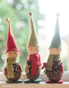 These darling Pine Cone Elves are easy to make and go perfectly with any Christmas decorations! Visit our 100 Days of Homemade Holiday Inspiration for more recipes, decorating ideas, crafts, homemade gift ideas and much more! - This Holiday Crafting Noel Christmas, Christmas Projects, Winter Christmas, Holiday Crafts, Christmas Ideas, Party Crafts, Pinecone Christmas Crafts, Pine Cone Christmas Decorations, Homemade Xmas Decorations
