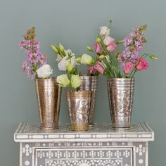 Vintage Indian lassi cups as vases - lovely!