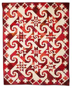 Virginia Stars Sampler by Agneta M. Noe. 2009 Empire Quilters Guild Showcase. Sixteen red and one off-white fabrics and Judy Martin's book, Knockout Blocks and Sampler Quilts