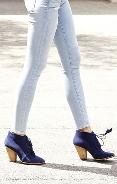 Lace-up blue suede booties with fun tassels. I need these boots in my life~
