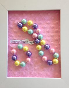 A classic bubblegum bead necklace in yellow, pink, purple and aqua $12. Add a matching bracelet for just $5 with any necklace purchase.